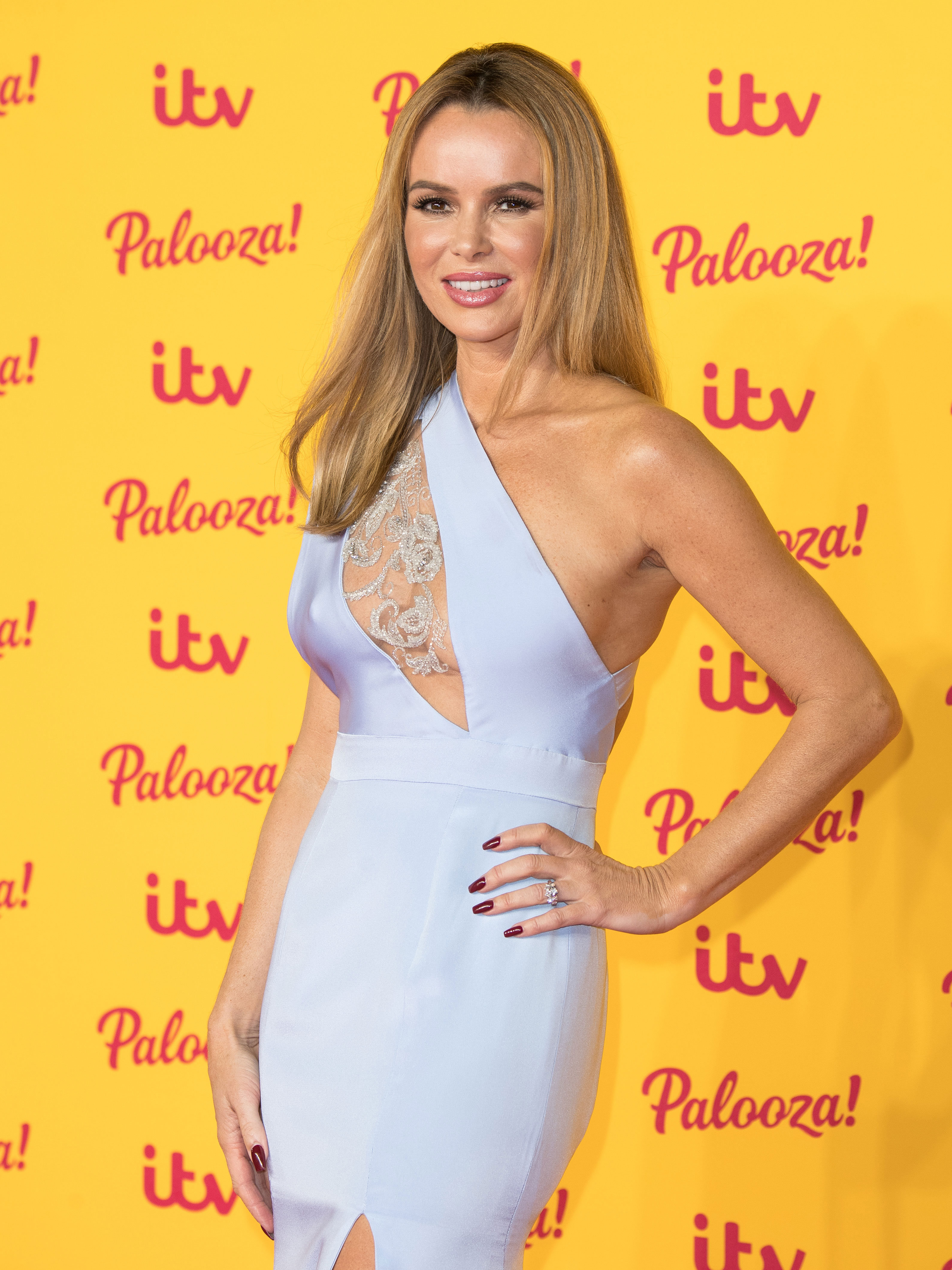 Amanda Holden admits she loves when people talk about her 'tired old breasts' as she hits back at revealing outfit criticism