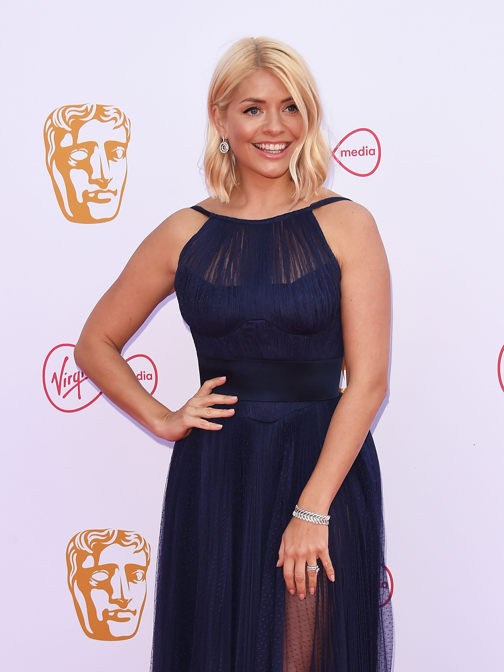 Holly Willoughby stuns in white swimsuit as she shares rare snap of son