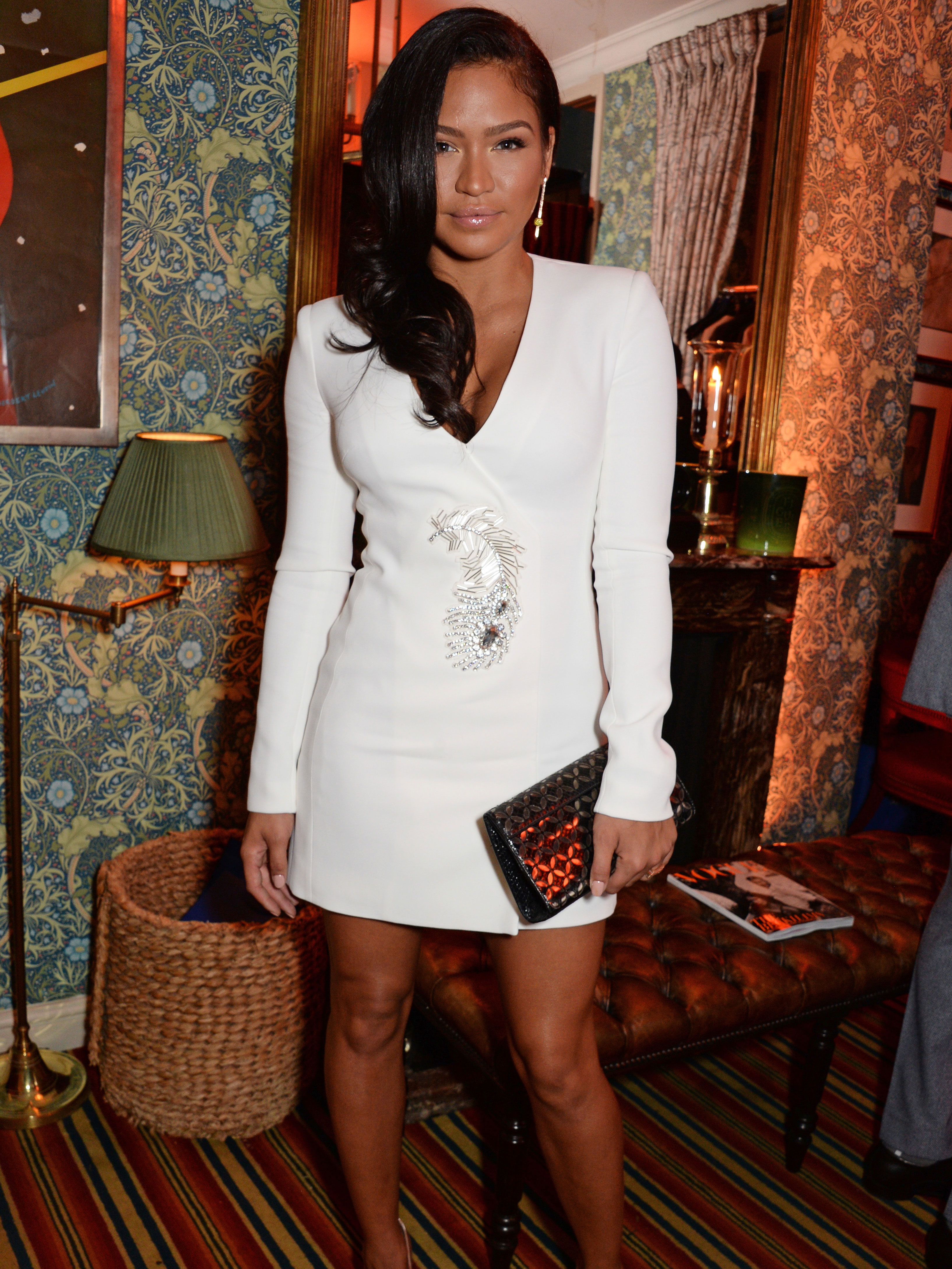 Cassie proudly bares pregnancy bump as she poses in fishnet tights