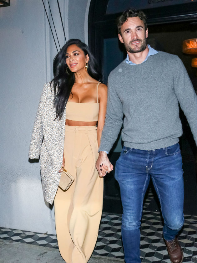 Thom Evans and Nicole Scherzinger stun with washboard abs gym snap