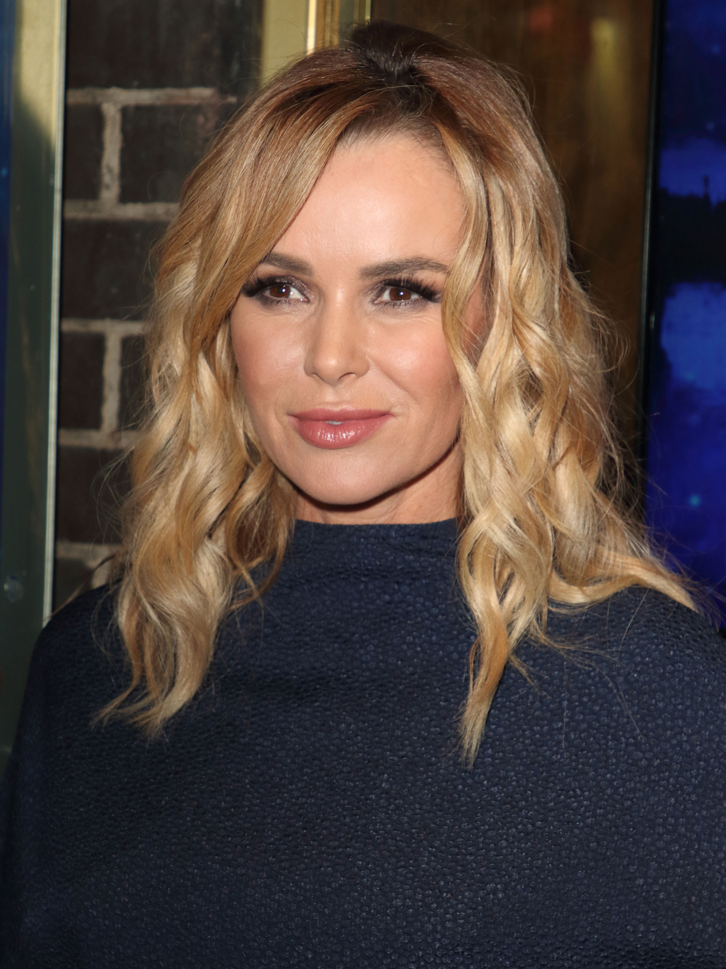Amanda Holden shows off legs in knee high leather boots in the best way