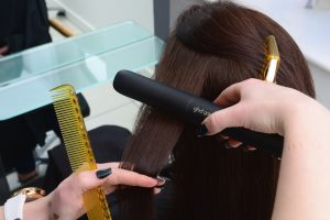 Curl the hair using hair straightner