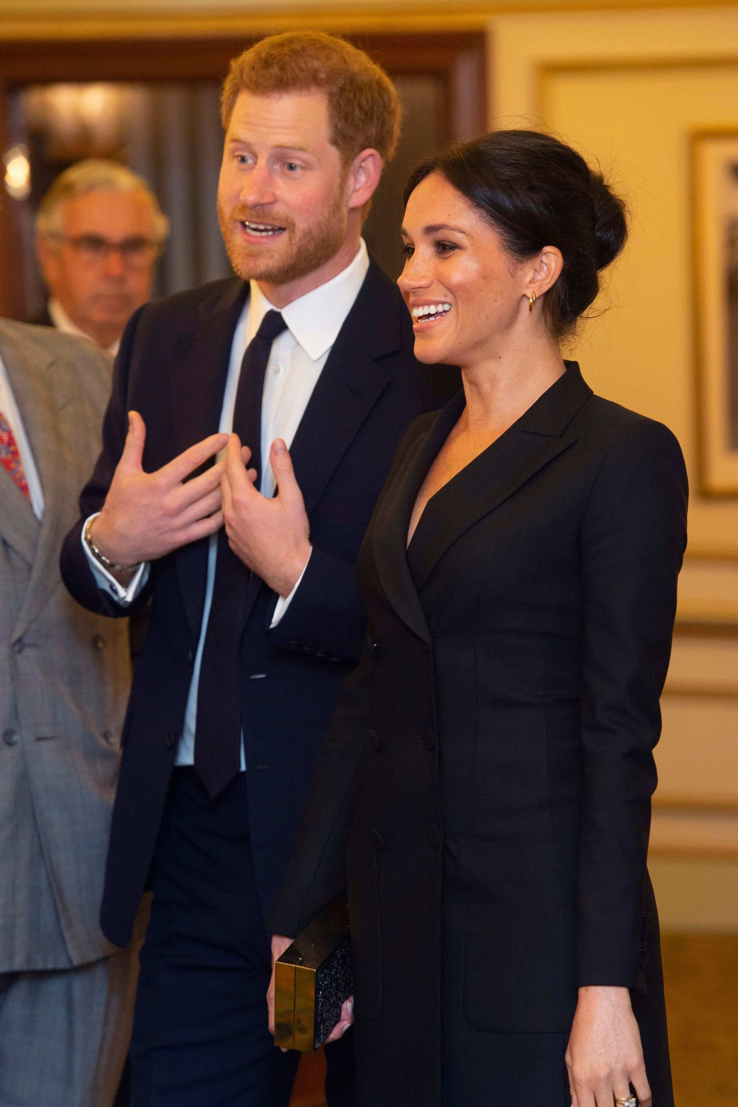 Prince Harry wows crowds with his adorable' singing voice as he attends musical with wife Meghan