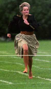 The Princess of Wales running towards the finishing tape in the Mothers' Race at Wetherby School Sports Day at the Richmond Athletics club. Prince Harry, her younger son, also took part in the events.