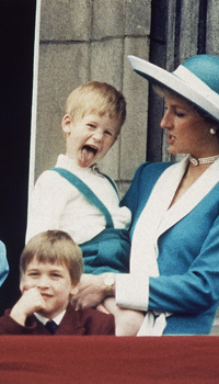 Britain's Prince Harry sticks out his tongue for the cameras on the Royal Balcony of Buckingham Palace in London, England on June 11, 1988, following the trooping of the Colour. Princess Diana holds Harry, as a smiling Prince William sits in front, and Lady Gabriella Windsor is seen on the left. (AP Photo/Steve Holland)