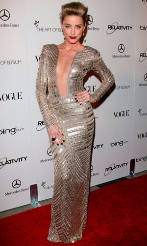 Amber Heard wears an embellished Julien MacDonald gown on the red carpet
