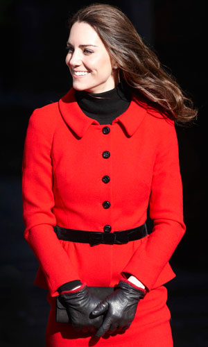 Kate Middleton wearing a red and black suit on a royal visit to Scotland
