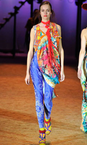 A model shows off a colourful look on the catwalk at Graduate Fashion Week 2010