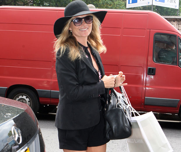 Kate Moss In London Wearing Trademark Black Hat Shorts Blazer and Ballet Pumps