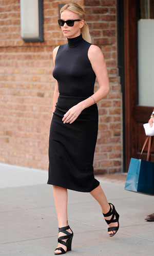 Charlize Theron looking chic all in black on the streets of New York.
