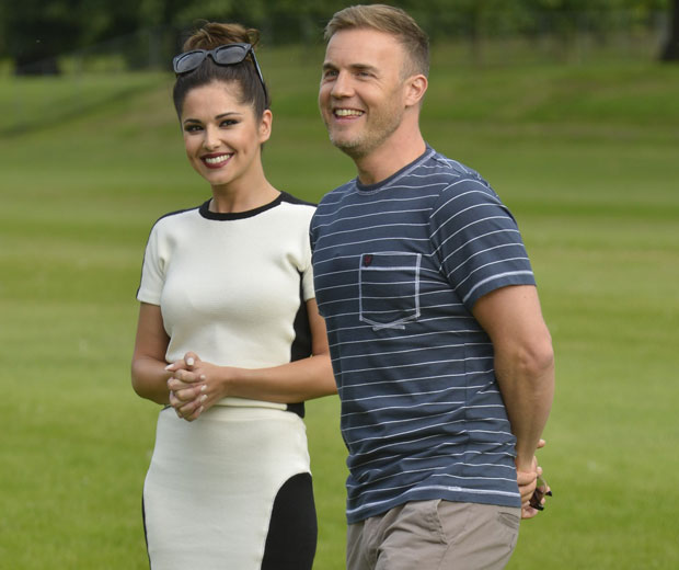 Cheryl Cole helps out Gary Barlow in the judges' houses stage of the competition