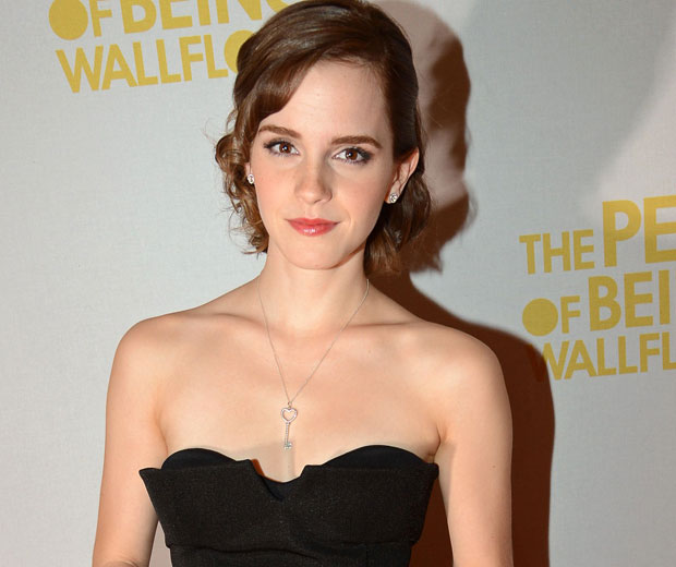Emma Watson has revealed that she can't bear to watch the kissing scenes in her new movie