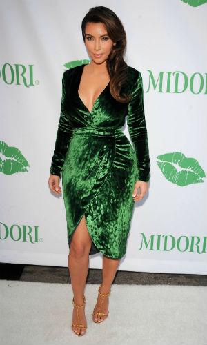 Kim Kardashian dazzles in a green velvet dress