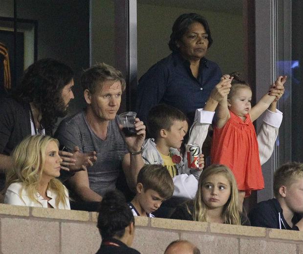 Russell Brand, Gordon Ramsay, Victoria Beckham and Harper watch an LA Galaxy match