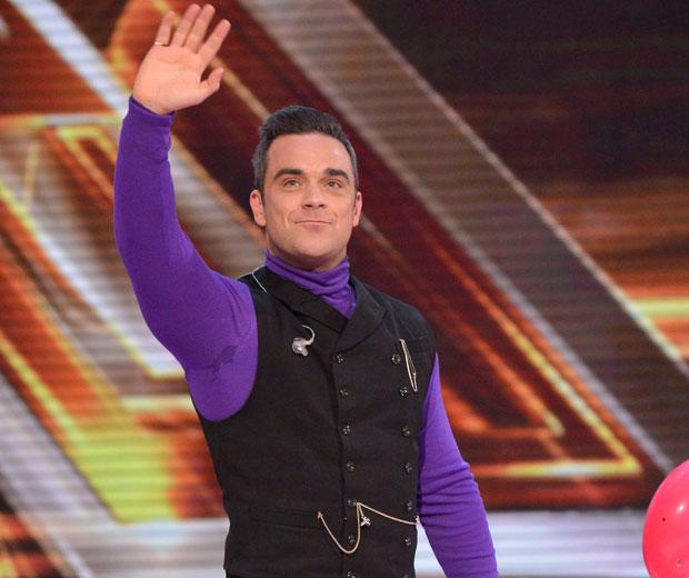 Robbie Williams has revealed he has a huge crush on Mila Kunis