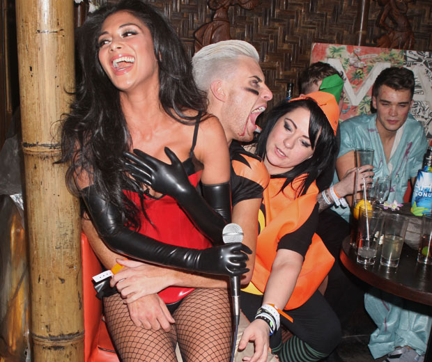 X Factor's Rylan Clark had Nicole Scherzinger and Lucy Spraggan on his lap in the nightclub