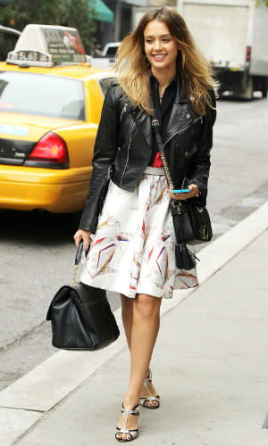 Jessica Alba wearing a leather jacket with a summery skirt