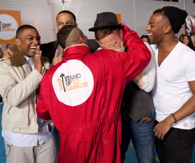 JLS comfort Olly Murs after the cannon stunt!