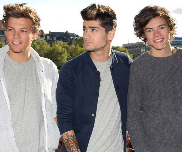 Louis (left) with his bandmates Zayn and Harry on the road with One Direction!