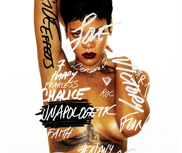 Rihanna shows off her tattoo in this topless album cover!