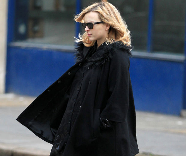 Pregnant Fearne covered her baby bump in a chic winter coat for work this morning