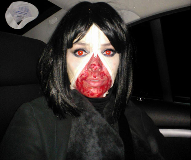 Holly Willoughby dressed up as a creepy 'unzipped' character for Halloween