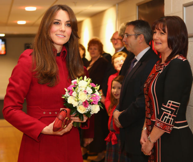 Kate Middleton opted for a formal red winter coat for her rugby date with William
