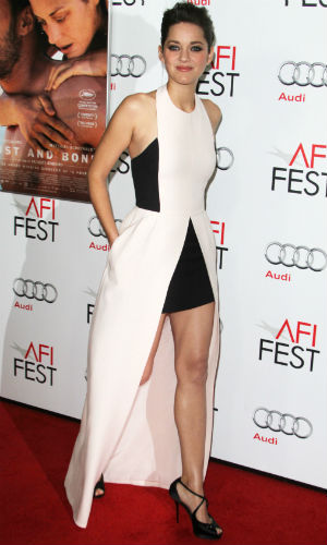 Marion Cotillard wearing a white and black Dior dress on the red carpet