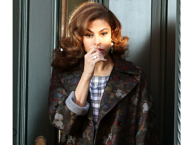 eva mendes in a butterfly print coat from her new york and company line
