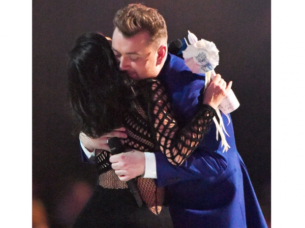 kim kardashian giving Sam Smith the Global Success award at the BRITs