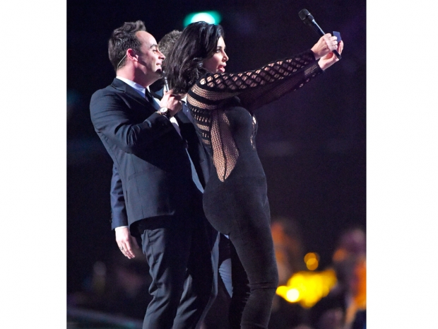 kim kardashian on the brits stage taking a selfie with Ant and Dec