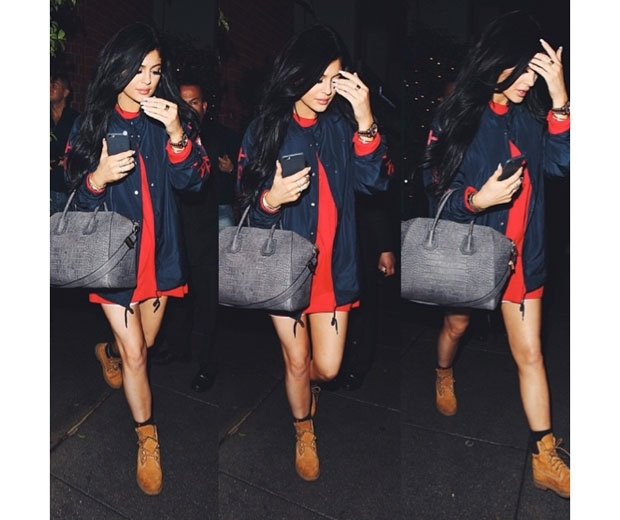 kylie jenner in a red tshirt dress and a dark blue denim jacket