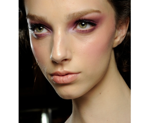 Enhance your green eyes with a shot of pink or purple