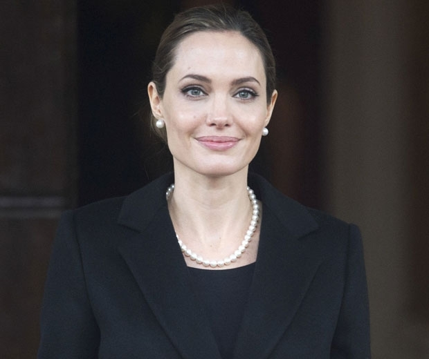 Angelina jolie in a black suit