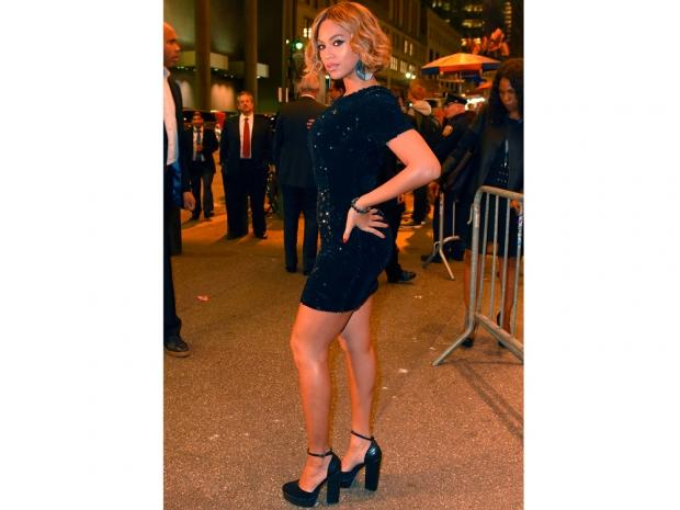 beyonce in a black dress and platform heels