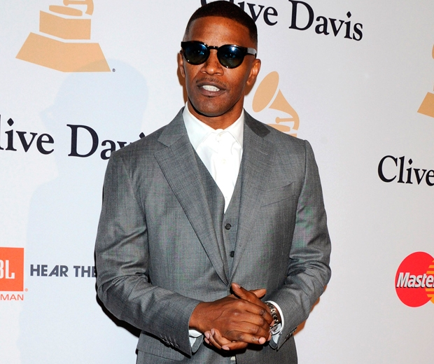 jamie foxx in a grey suit at the pre-grammys party