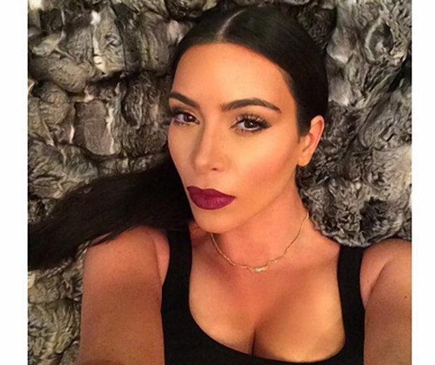Kim Kardashian posing for vampy red lip selfie on Instagram