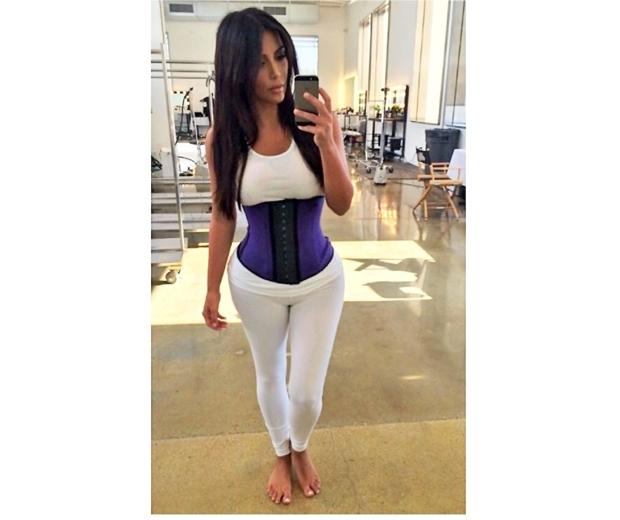 kim kardashian at the gym with waist trainer