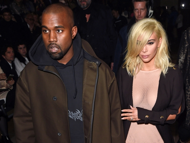 kim kardashain with blonde hair with kanye west at lanvin show