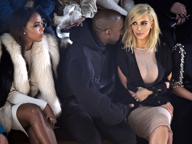 Kim kardashian with kanye west and kelly rowland on the lanvin frow