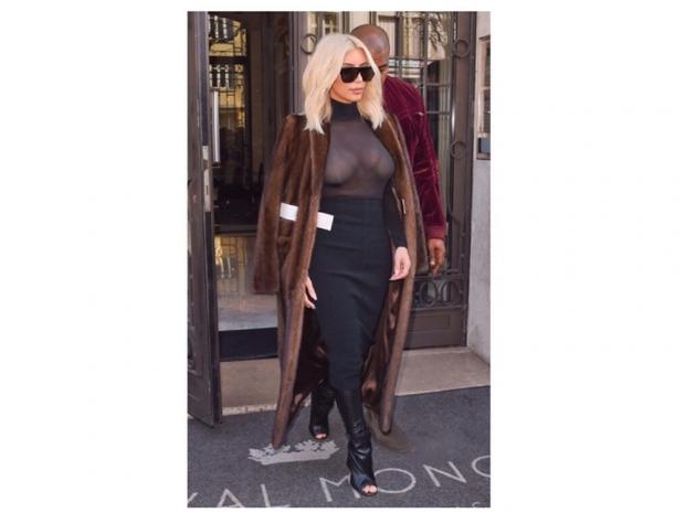 kim kardashian in mesh top at paris fashion week