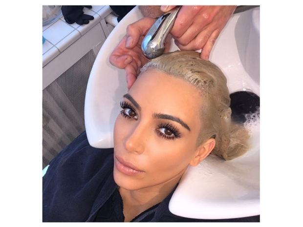 kim kardashian blonde at hairdressers getting roots done