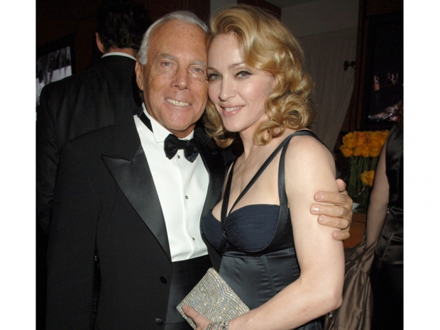 Madonna and Giorgio Armani posing together at a party back in 2007