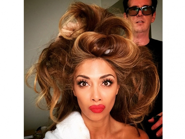 nicole scherzinger with a red lip and big hair