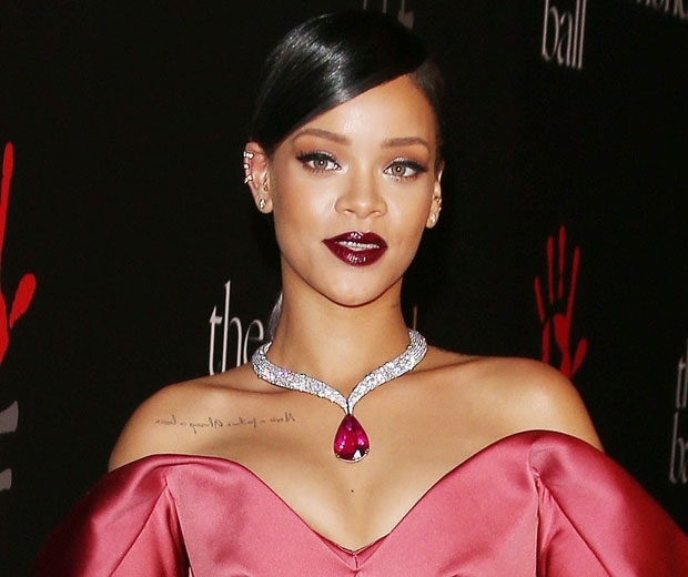 rihanna in a red zac posen dress and diamonds
