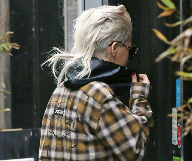 rita ora with check shirt and platinum blonde mullet hair