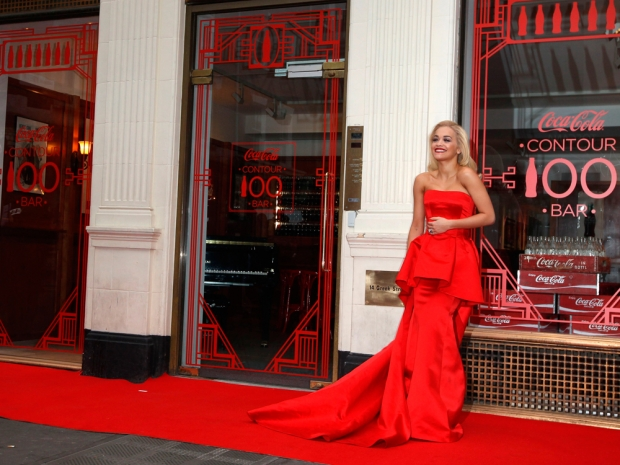 rita ora at the coca cola anniversary shop in a red dress