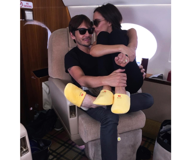 victoria beckham in a pair of fluffy yellow plane slippers
