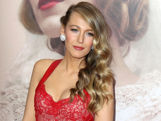 Blake Lively with wavy hair and diamond earrings at The Age Of Adaline premiere