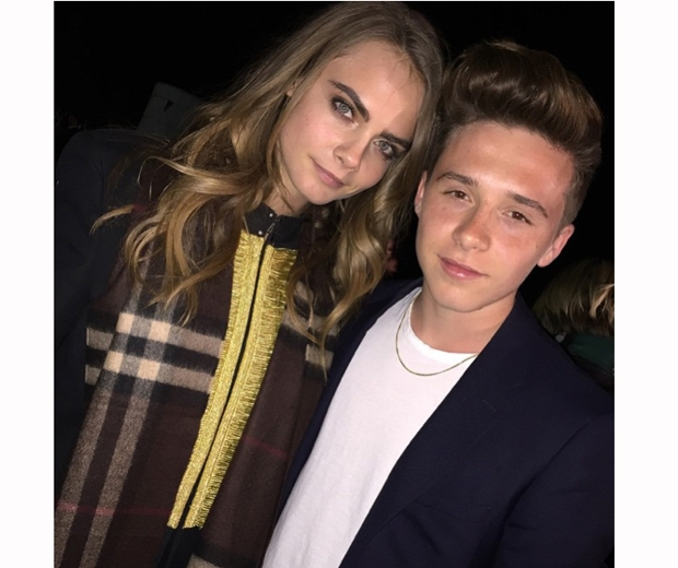 brooklyn beckham and cara delevingne at burberry show